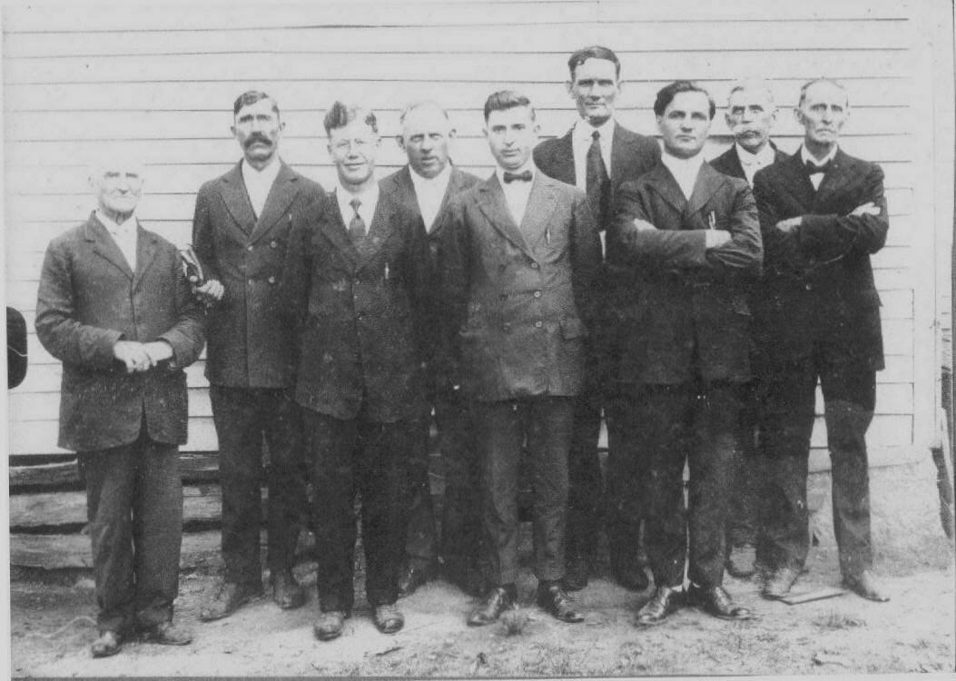 A group of ministers in front of the old parsonage